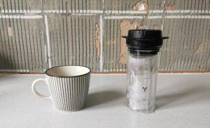 delter coffee press and a cup