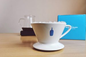 Blue bottle dripper on table