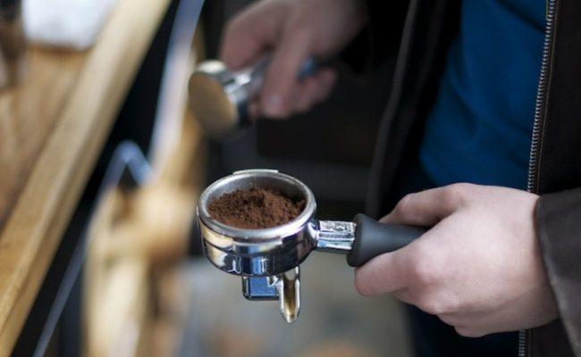espresso being tamped
